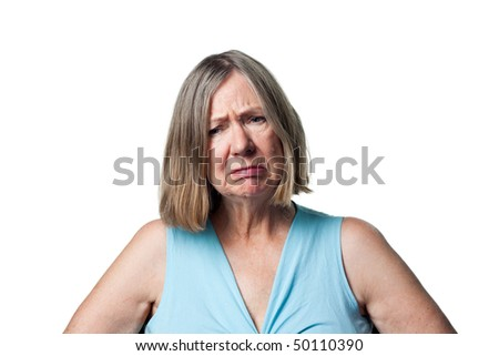 Older woman upset, saddened and disappointed by some news - stock photo