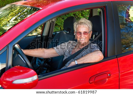 Older Woman when wearing a seat belt in a car. - stock photo