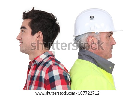 Older workers and young workers - stock photo