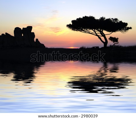 Oldest neolithic prehistoric temple built thousands of years before the pyramids. - Hagar Qim & Mnajdra Temples in Malta, Mediterranean Sea, Europe - here seen silhouetted at sunset - stock photo