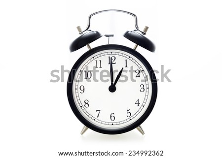 Oldfashioned black glossy alarm clock showing 1 o'clock