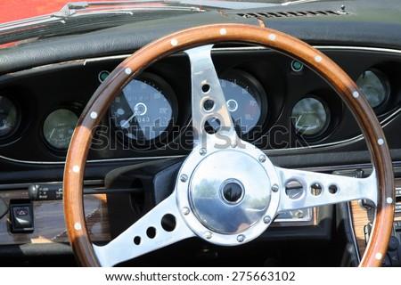 Oldtimer car steering wheel. Old Timer car steering wheel. - stock photo