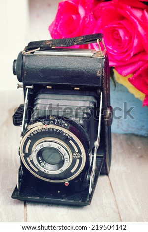 oldvintage  photo camera with flowers - stock photo