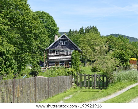 OLESNO, CZECH REPUBLIC - JUNE 7: Wooden House of  village conservation community Olesno on June 7, 2014. Olesno located in the Protected Landscape Area Kokorinsko, Central Bohemian Region.