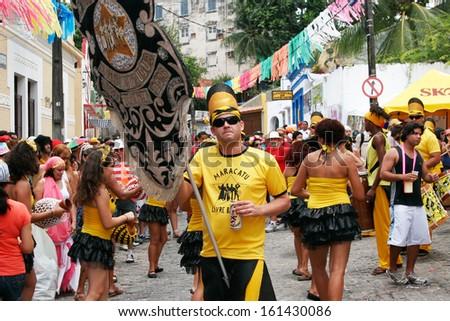OLINDA, BRASIL - FEB 19: Revelers dance in celebration of the frevo carnival on February 19, 2012 in the old town of Olinda, Pernambuco, Brasil - stock photo