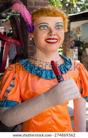 OLINDA, BRAZIL - APRIL 28: Brazilian carnival festival costume very popular in the citiy of Olinda in PE, Brazil made of fabric, paper, and wood photographed on April 28, 2015 in Olinda, PE, Brazil. - stock photo