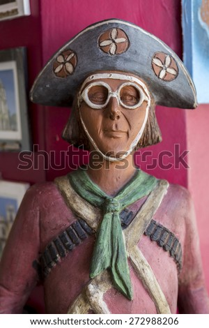 OLINDA, BRAZIL - APRIL 26: Sculpture in clay of the notorious Brazilian outlaw nicknamed Lampiao who became an icon of the culture of the northeast region of Brazil as seen on April 26, 2015. - stock photo
