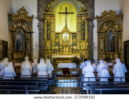 OLINDA, BRAZIL - APRIL 26: The interior architecture of the Nossa Senhora da Misericordia church with its golden altars and sculptures during a service on April 26, 2015 in Olinda, PE, Brazil. - stock photo