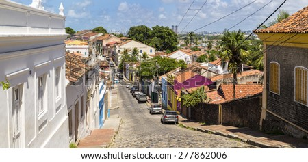 OLINDA, BRAZIL - MAY 14: The historic architecture of Ladeira da Misericordia street in Olinda, PE, Brazil on a sunny day with its cobble stones and houses dated from the 17th century on May 14, 2015. - stock photo