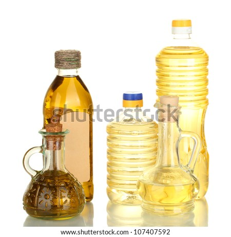 Olive and sunflower oil in the bottles and small decanters isolated on white - stock photo