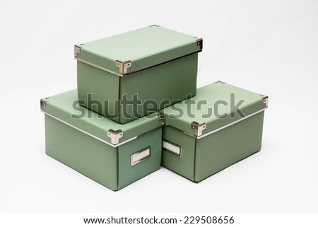 olive green storage boxes isolated on white background