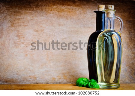 Olive oil and balsamic vinegar with text copy space on a wooden background - stock photo