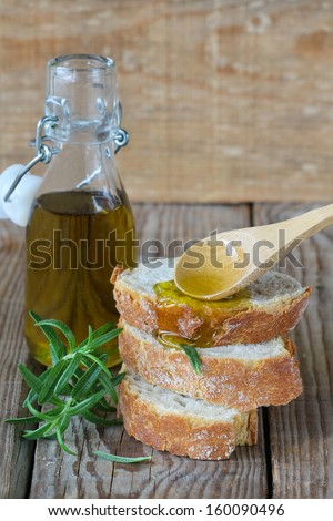 Olive oil and bread - stock photo