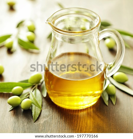 olive oil and olives - stock photo