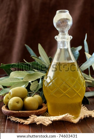 olive oil and Olives on a wooden table - stock photo