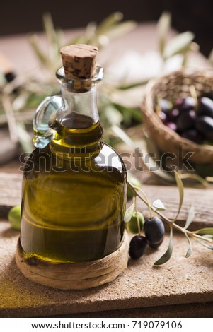 Olive oil and olives on wooden rustic table