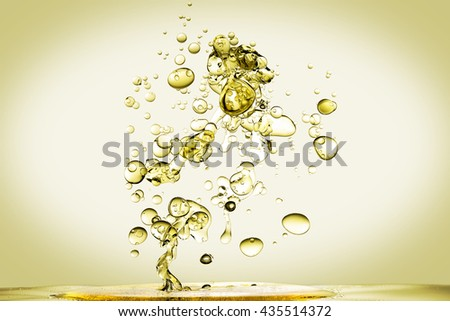olive oil being poured into water - stock photo
