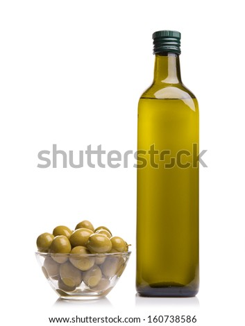 Olive oil bottle and olives on white background - stock photo