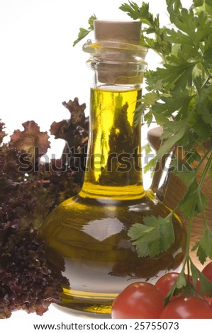 Olive oil bottle close-up with fresh vegetables