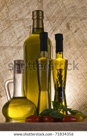 Olive oil bottle still-life over  textured background with back light