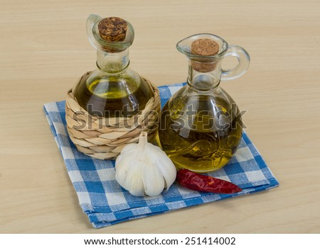 Olive oil bottles with garlik and pepper - stock photo