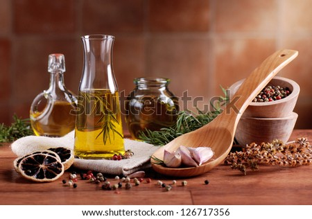 olive oil flavored with spices and other ingredients - stock photo
