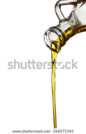 Olive oil flowing from carafe isolated on white background - stock photo