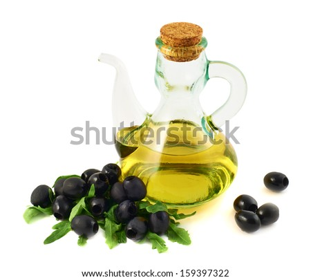 Olive oil glass vessel with a spout and cork plug, composed with arugula and black olives, isolated over white background - stock photo