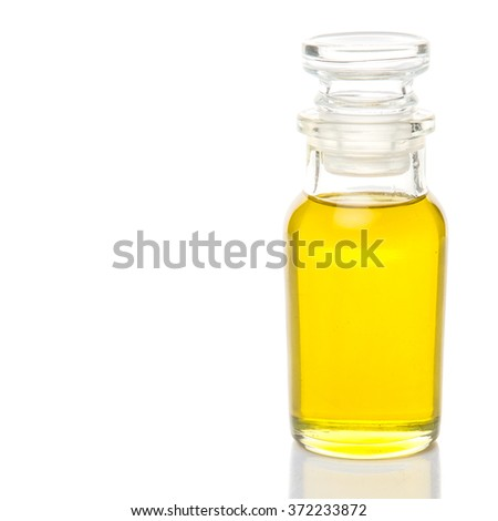 Olive oil in a glass bottle over white background