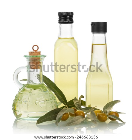 Olive oil in bottles on white background - stock photo