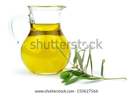Olive oil in glass carafe and green olive branch isolated on white background. - stock photo