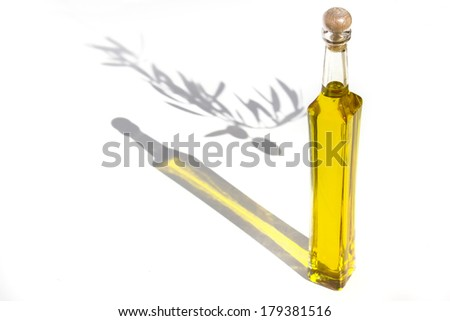 Olive oil is a fat obtained from the olive.The oil is produced by pressing whole olives. Olive oil is the main cooking oil in countries surrounding the Mediterranean Sea. - stock photo