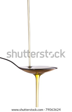 olive oil jet isolated over a white background - stock photo
