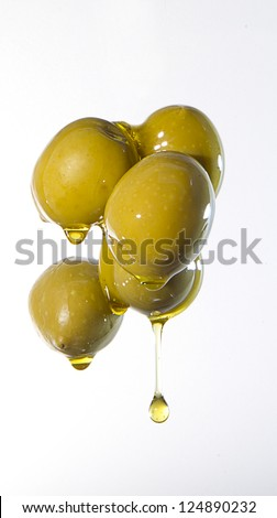 olive oil olives falling on - stock photo