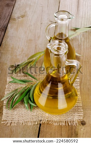 Olive Oil on a wooden table - stock photo