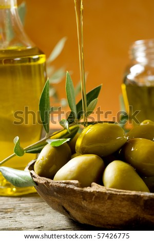 olive oil over olives - stock photo