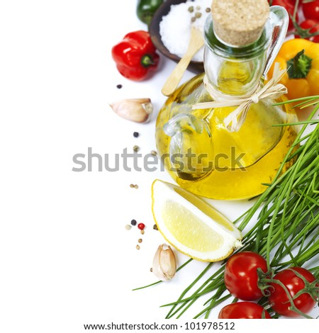 Olive oil, pepper, salt and  fresh vegetables, herbs and spices - stock photo
