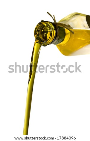 Olive oil poured from an original bottle isolated on white background with clipping path - stock photo