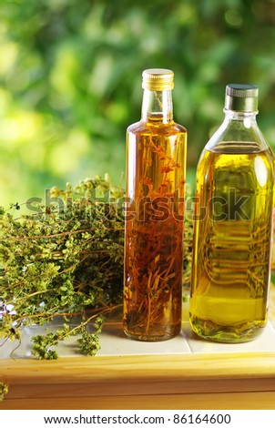Olive oil,vinegar, and oregano herb. - stock photo