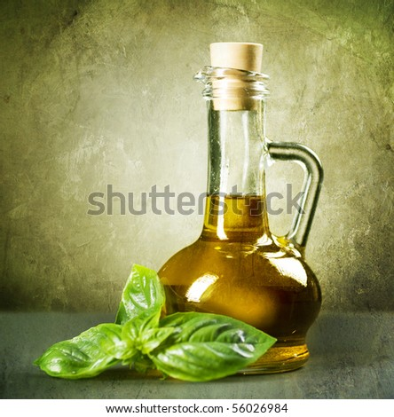 Olive Oil with fresh Basil.Vintage Styled. - stock photo