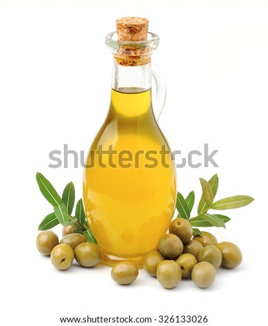 Olive oil with olives close up on white - stock photo
