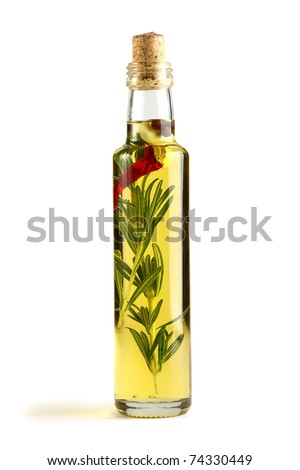 Olive oil with rosemary, garlic and pepper isolated on a white background. - stock photo
