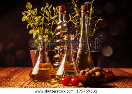 Olive oils i bottles. Food ingredients - stock photo