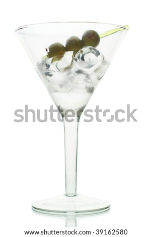 Olive on skewer, on ice cube in martini glass - stock photo