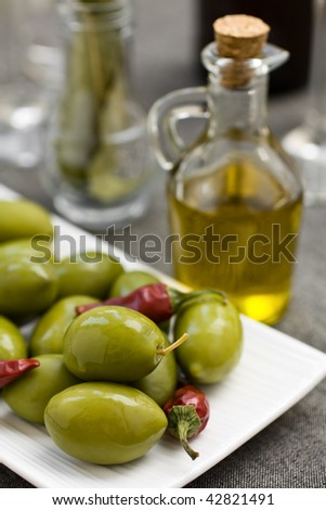 Olives and olive oil in a bottle - stock photo