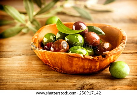 Olives and Olive Oil on the wooden table - stock photo