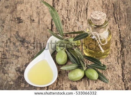 olives and olive oils on wooden table