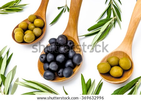 Olives and olives leaves on a white background - stock photo