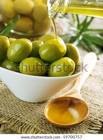 Olives and Pouring Olive Oil - stock photo