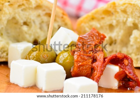 Olives, feta cheese and sun dried tomatoes - stock photo
